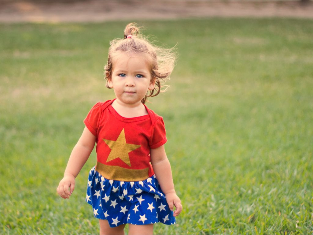 Young girl in Wonder Woman costume